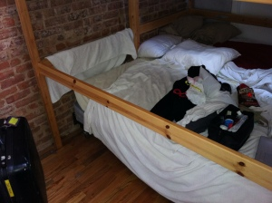 Bunk beds pushed together in a private hostel room