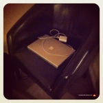 My old Mac PowerBook laptopon our leather chair.