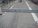 02-welcome-to-brooklyn-sign-bridge-path-walkway-bike