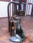 This is some kind of bronze sculpture at the end of the gallery. It's a fountain with a wine bottle, only instead of wine, it pours harmless, boring water.
