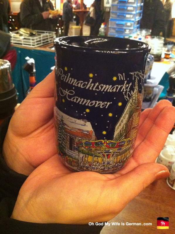 "Now HERE is a traditional Weihnachtsmarkt mug. So charming! They're almost charming enough to make me forget the €2 euro deposit I had to pay on top of the €2.5 euros for the Glüwein itself. Really? A deposit? These Germans... they think I'm going to steal a mug so I can take it home with me. I am offended. (And I am much more likely to lob my mug like a grenade into the swarm of Christmas shoppers. ""Incoming!"")"
