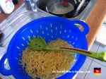 pasta drying in a strainer