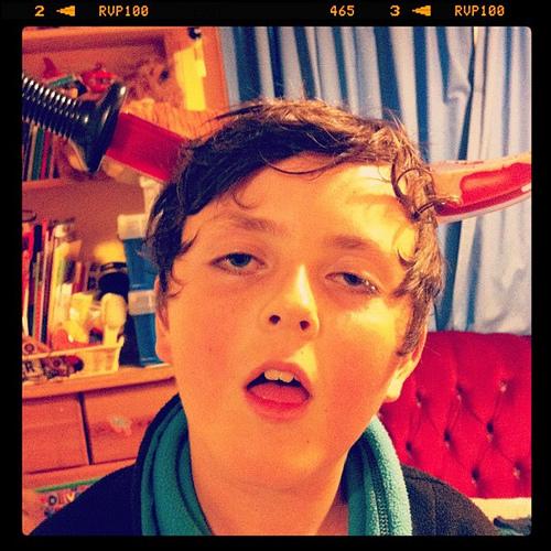 headache funny kid with sword through head