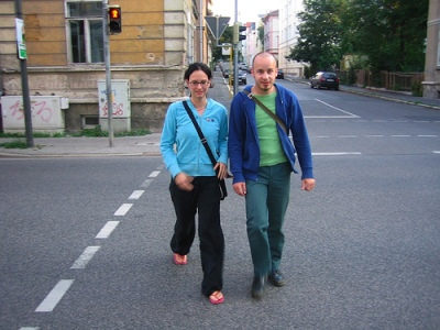 couple crossing street on red light in germany don't walk sign