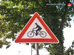 "I love the detail in this  sign. ""CAUTION: Straight-backed nerds on bikes ahead."""