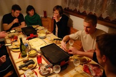 A traditional Swiss raclette dinner evening with table-top grill