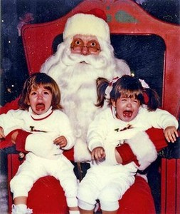 Funny Santa at Christmas with screaming, crying kids.