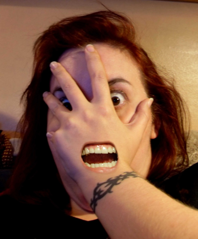 scary mouth hand covering face