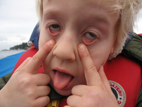 funny-kid-making-face-eyes-zombie-tired