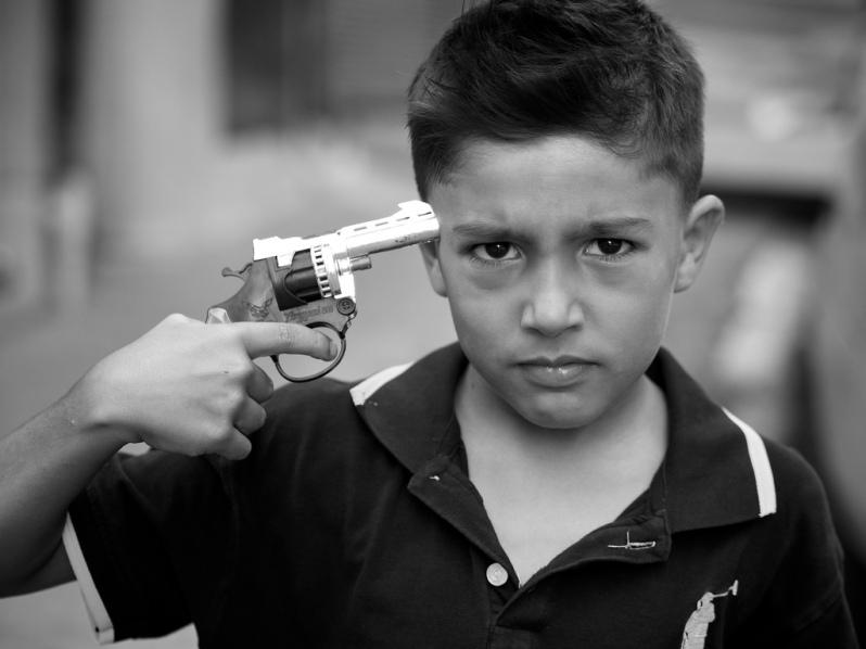 funny-turkish-boy-with-gun-to-head