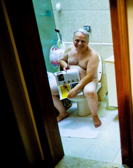 man-on-toilet-funny-sitting-to-pee