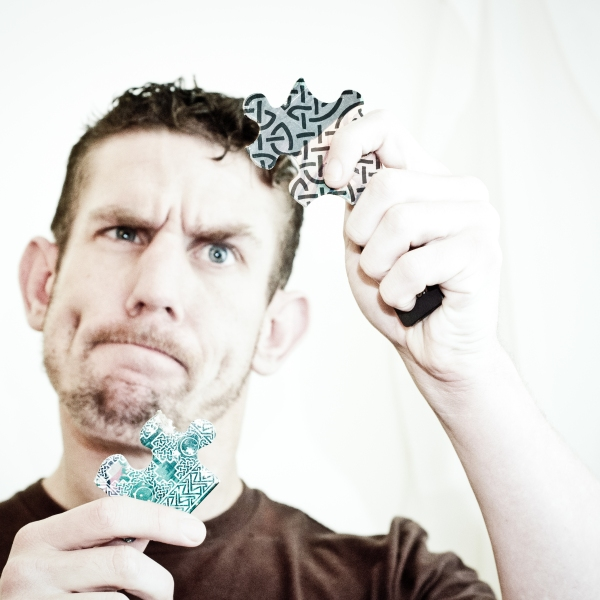 learning-german-confused-man-with-puzzle-pieces-fit-together