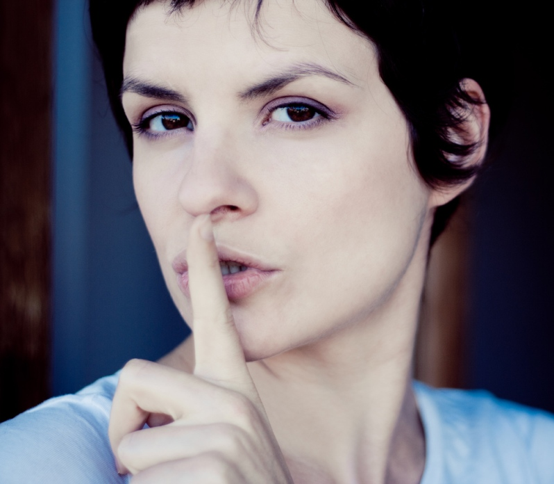 hush-dont-speak-finger-to-lips-woman-german-proverbs
