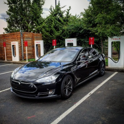 We saw this Tesla charging at the Woodburn Outlet Mall. So awesome. I wish I could recharge my batteries with just a simple plug up my ass.
