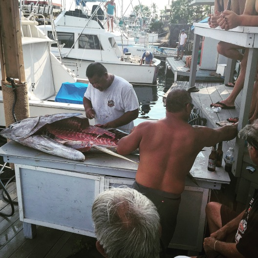 Here's some dude cutting up a big fish. This was not our fish and we were given none of it.