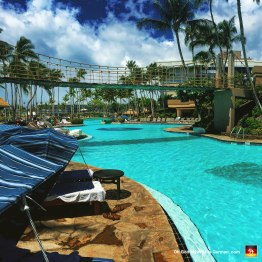 """One of many pools at Hilton Waikoloa Village. Notice how absolutely no one is in this particular pool? That's because, according to the security guard I asked, """"Someone left a Baby Ruth in the water."""" (I am not joking. They evacuated the entire pool for like 3 hours.)"""