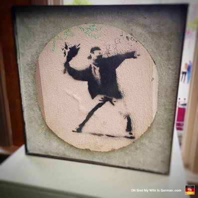 26-banksy-exhibit-amsterdam-flower-thrower-riot