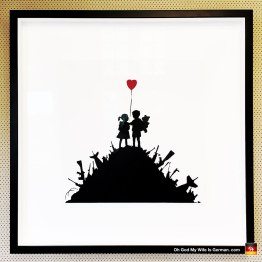 28-banksy-exhibit-amsterdam-boy-and-girl-heart-war-wilhouette