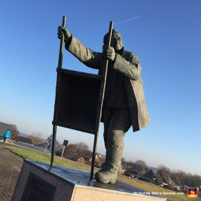 This is the Deichbauer-Denkmal (Dike Builder Memorial). It memorializes all of the people in Dorum-Neufeld who died in floods and storms (as a direct result of this man's incompetence, I presume).