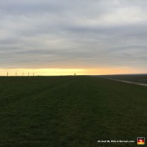 """Sunset at the North Sea. You can really see just how far the dike goes. (Am I even allowed to say """"dike"""" anymore? Fine. LEVEE. It's a levee.)"""
